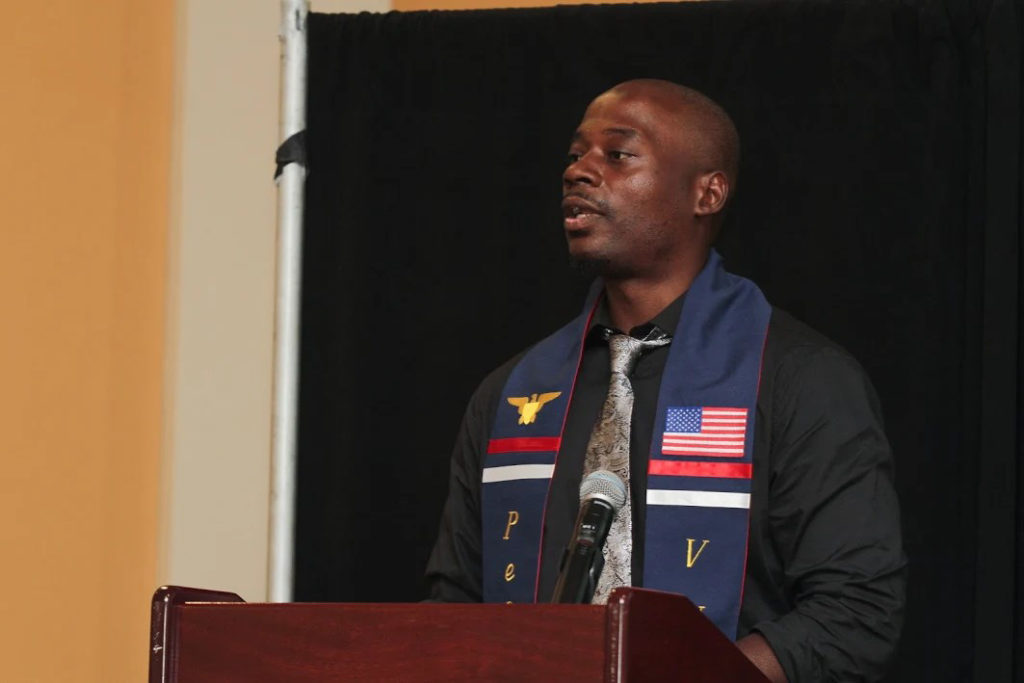 Veteran Michael Doe speaks at Penn VUB's 2018 graduation ceremony.